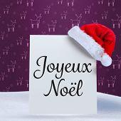 Joyeux noel against purple reindeer pattern