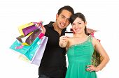 attractive young couple shopping with credit card