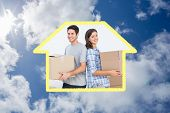 Wife and husband carrying boxes against bright blue sky with clouds