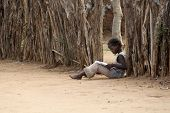 Portrait Of A African Little Girl Reading A Book