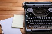 Antique Typewriter. Vintage Typewriter Machine on wooden table
