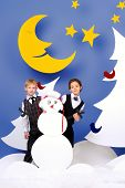 picture of boys night out  - Cute girl and boy playing together in a cartoon fairy snowy forest - JPG