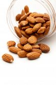 Almonds In The Plastic Jar On White