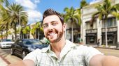 Happy young man taking a selfie photo in Los Angeles, USA