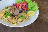 Thai style stir fried rice noodle with duck and vegetable