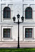City Lantern On The Background Wall Of The Palace. Riga