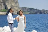 Bride And Groom Making A Toast With Champagne Near Sea, Naples, Italy