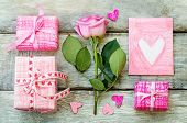 Valentine's Background With A Gifts, Flower And Card