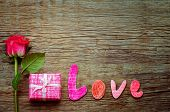 Valentine's Background With Gift, Flower And Word Love