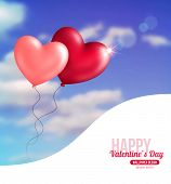 Valentine heart-shaped balloons in blue sky with clouds