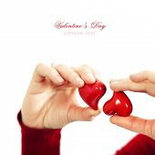 Red hearts  in hands - St. Valentine concept. With easy removable sample text
