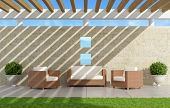 stock photo of pergola  - Garden with sofas and armchairs under a pergola  - JPG