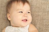 Baby Girl Smiling Looking Away