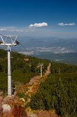 pic of ropeway  - Chair ropeway in mountains in early autumn - JPG