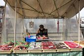 TAKAYAMA, JAPAN - DECEMBER 3, 2014: Vendors at their shop at the Miyagawa morning market in Takayama, Japan. This marketplace sells food items, groceries to farm produce and is common in rural Japan.