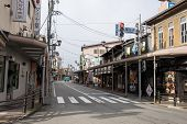 TAKAYAMA, JAPAN - DECEMBER 3, 2014: Low rise buildings and clean streets with few cars is a common cityscape find in Japan. Strong environmental laws keeps the nation clean and green.