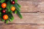 Fresh ripe mandarins  and fir tree bud on wooden background