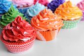 Delicious cupcakes on white background