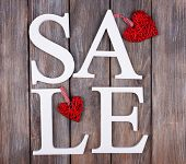 Sale on wooden background