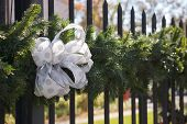 Holiday bow on a iron gate