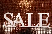 Sale on shiny background