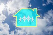 Cloud in shape of family against bright blue sky with clouds