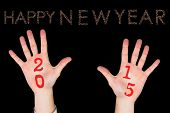 Hands against glittering happy new year