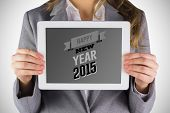 Businesswoman showing a tablet pc against happy new year