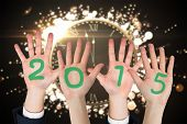 Business peoples hands against black and gold new year message