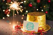2015 card on table set for party with gold hat and sparkler