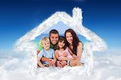 Portrait of a family at the beach against blue sky over clouds