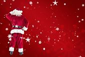 Santa Claus against red snowflake background
