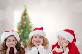 Cute children against blurry christmas tree in room