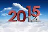 2014 and 2015 against bright blue sky with clouds
