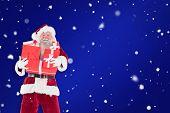 Santa carries a few presents against blue