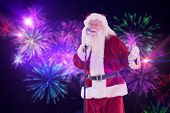 Santa sings like a Superstar against digitally generated bright firework design