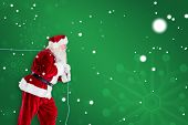 Santa claus pulling rope against green snowflake background