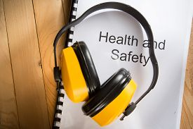 image of personal safety  - Health and safety register with earphones in closeup - JPG