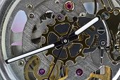 image of wind up clock  - The clockwork gear watch dial close up - JPG