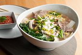 pic of rice noodles  - Closeup of some Thai pho style soup with beef and clear rice noodles - JPG
