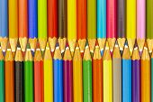 stock photo of zipper  - group of colorful pencils shows zipper as symbol for teamwork - JPG