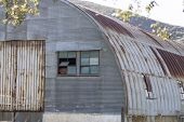 image of anza  - Building shed made of corrugated metal and rusted deterioration - JPG