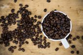 stock photo of coffee crop  - Coffee beans background on wooden - JPG