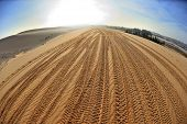 picture of four-wheel drive  - car tracks on the yellow sand in desert in Vietnam - JPG