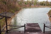 picture of pier a lake  - wooden pier beside the lake in forest - JPG