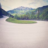 stock photo of italian alps  - Winding Paved Road in the Italian Alps Retro Effect - JPG
