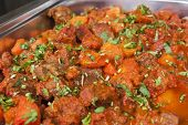 stock photo of buffet  - Closeup detail of a beef vindaloo curry on display at an indian restaurant buffet - JPG