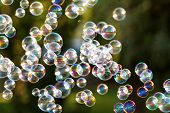 stock photo of blowers  - The rainbow bubbles from the bubble blower - JPG