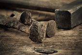 foto of wood craft  - Vintage old hammer with rusty nails on wood table background - JPG
