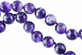 picture of beads  - Strings of amethyst beads isolated over white - JPG